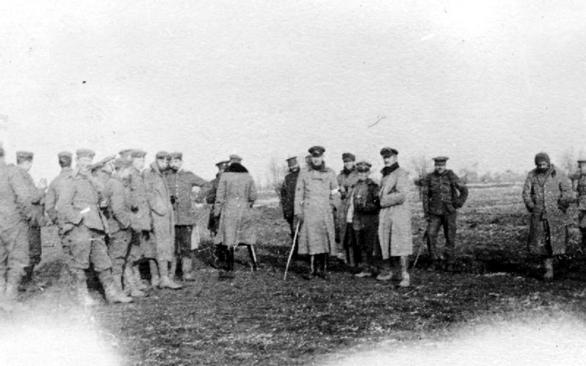 "British and German troops meeting in ""No-Mans's Land"" between camps during the unofficial truce of 12/25/1914."