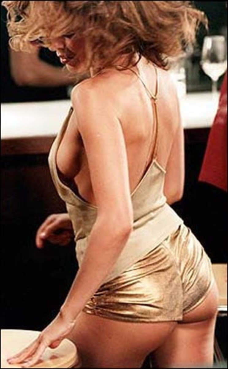 Kylie Minogue, hot in gold hotpants, rear view