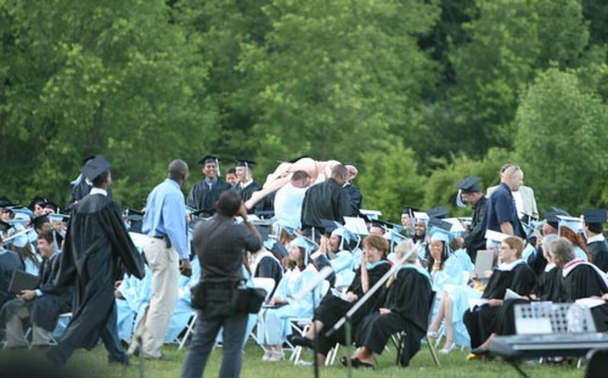 After the beach ball was taken away, students began to pass the blow up doll around during the graduation ceremony.