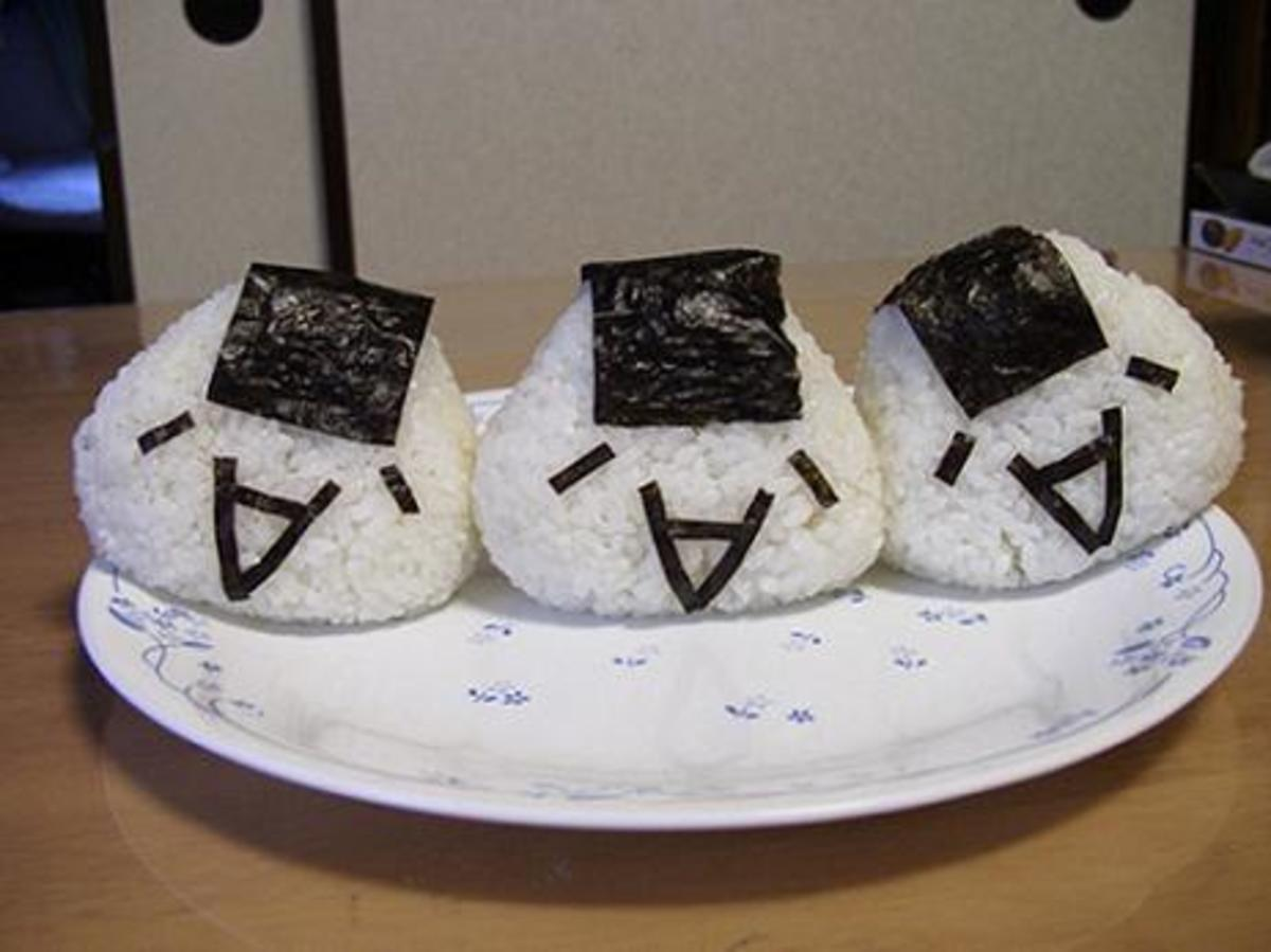 tiny bits of nori turn these simple onigiri into comical characters!