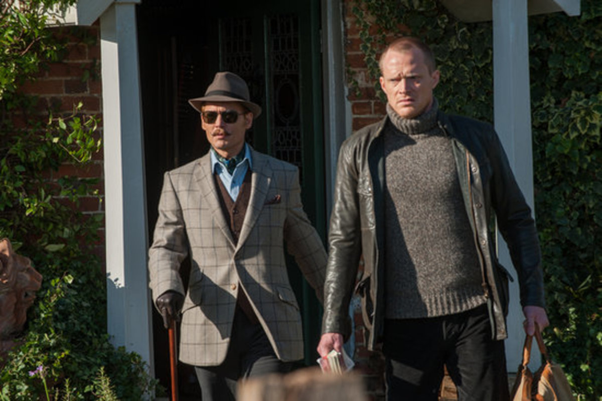 The Hon Charlie Mortdecai ( Johnny Depp) and his manservant Jock Strapp ( Paul Bettany)