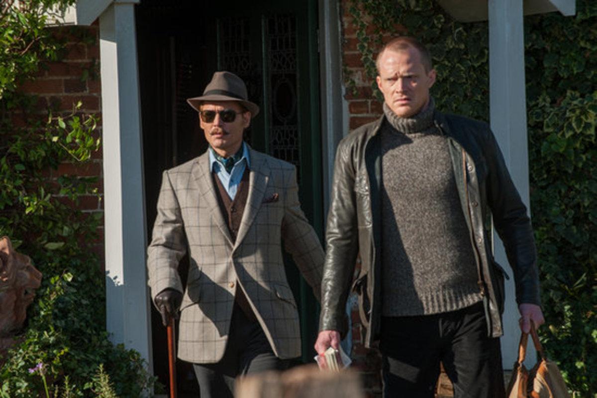 The Hon Charlie Mortdecai ( Johnny Depp) and his manservant Jock Strapp ( Paul Bettany)