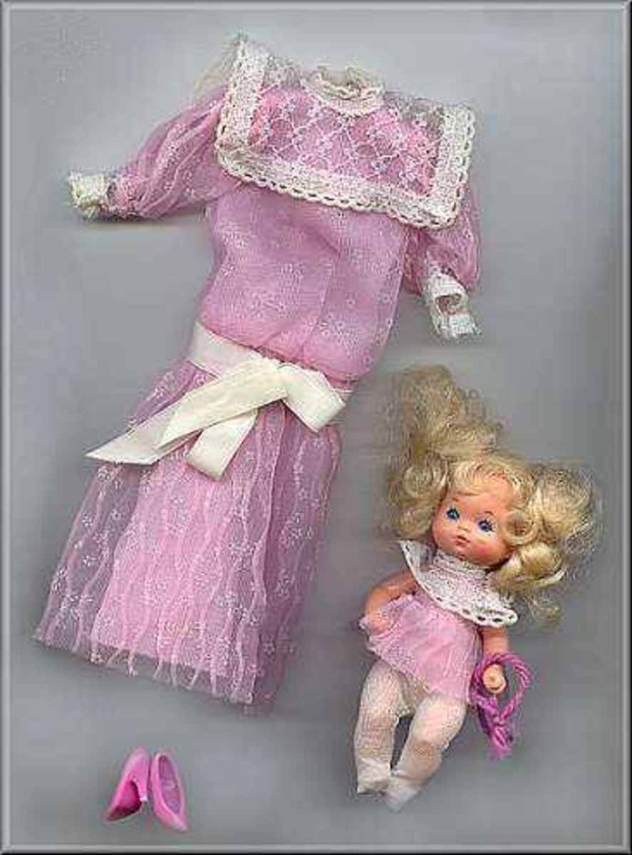 Mr. Heart was so overwhelmed by Barbie's generosity,  he gave her his ex-wife's dress that was thrown to the curb with the baby.