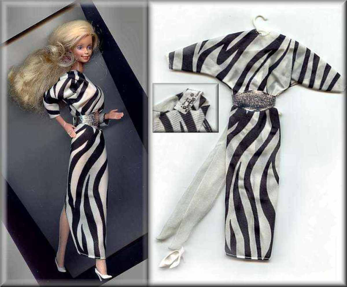 "She said she was one of the Mattel  dolls made to model  ""Genuine Barbie""  black and white label designer gowns and clothes.  Barbie hit the Paris runway wearing a  designer Zebra Stripe Dress complete with silver belt and shoes."