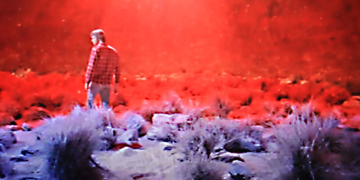 The Starman wanders alone across the crater to meet his space ship