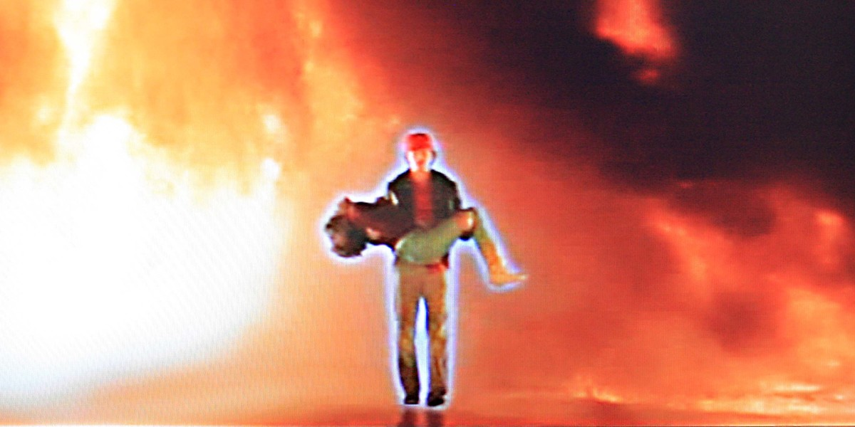 Some of the imagery has an almost messianic quality, though this scene of the Starman emerging intact from a blazing road crash (with Jenny in his arms) also has an uncanny resemblence to a scene in another movie of the same year - 'The Terminator'