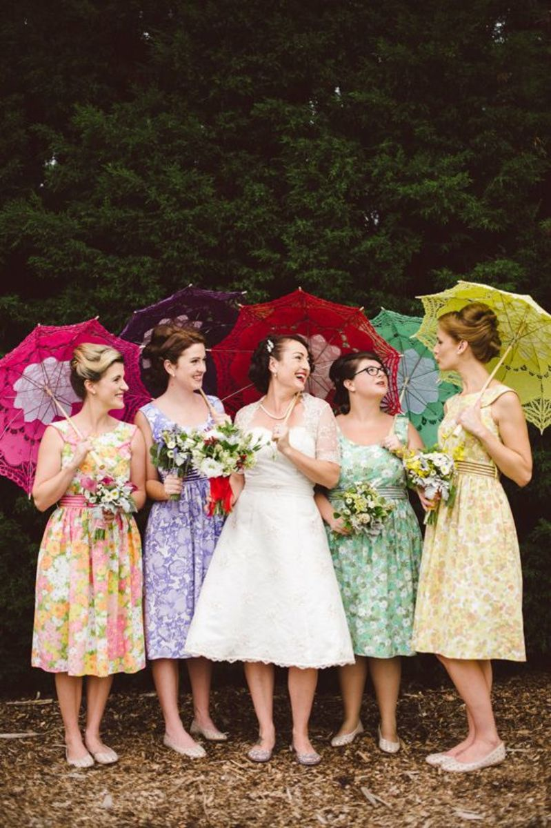 Colorful parasols to match the color of the bridesmaid's dress.