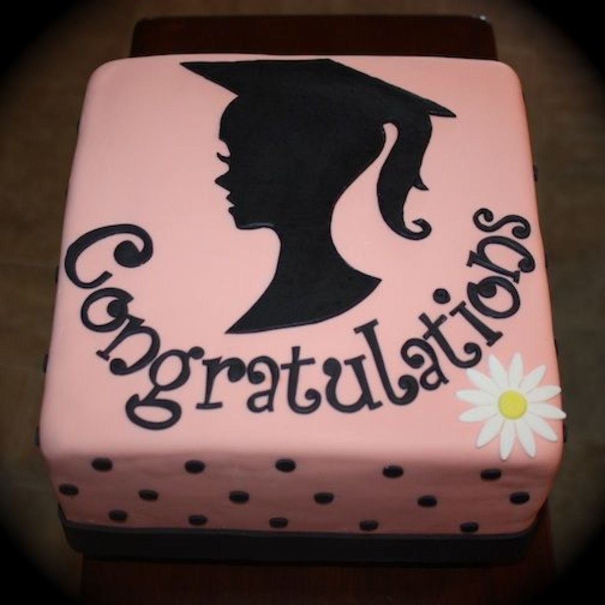 I stumbled upon this silhouette cake on Pinterest via Cake Central. This is a unique graduation cake idea!