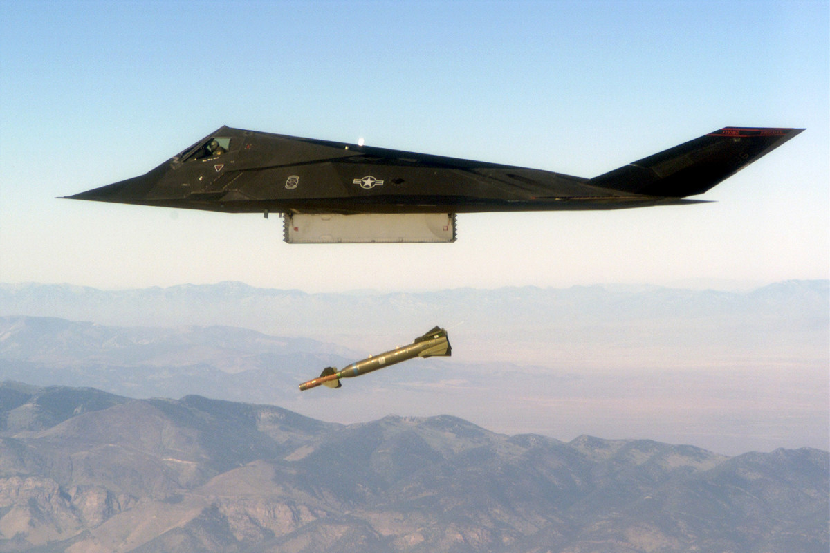 An F-117 on a live exercise dropping a GBU-27 laser-guided bomb.