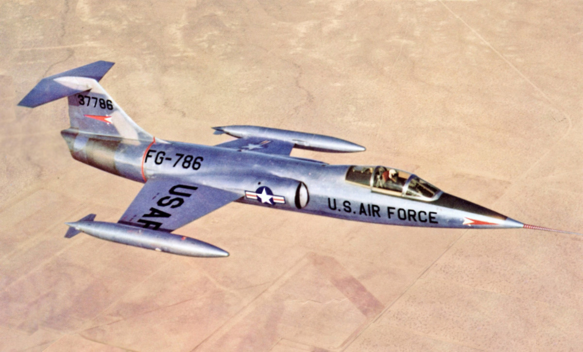 The F-104 Starfighter was the first combat aircraft capable of a sustained air speed of Mach 2 . The F-104 was the first aircraft to simultaneously hold the world speed (1,404 mph) and altitude records (103,3089 ft.).