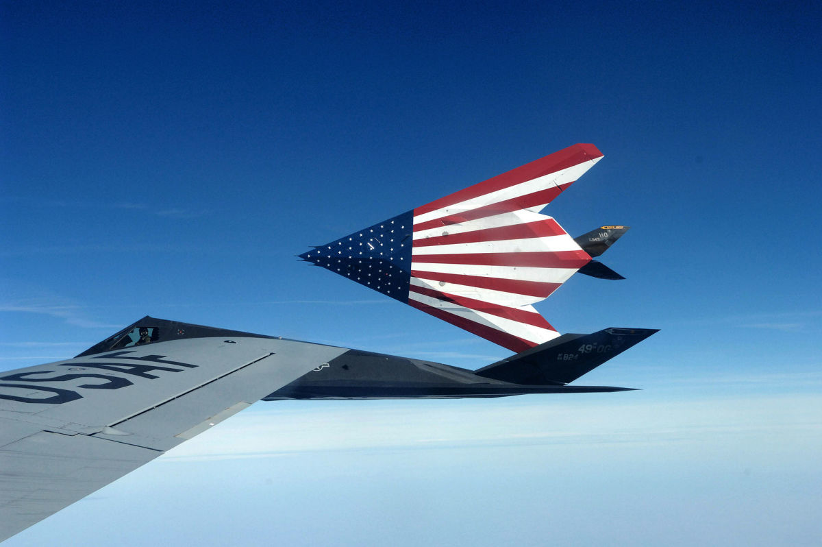 Two F117s on the way to an airshow with the American flag painted on the bottom of the aircraft.
