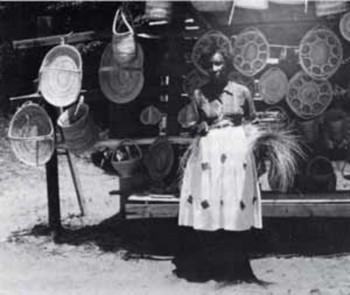 Mrs. Ida Wilson, coastal South Carolina, 1965. Gullah women still offer their baskets for sale along Route 17 north of Charleston. These baskets are constructed almost exactly like the Sierra Leone shukublay.