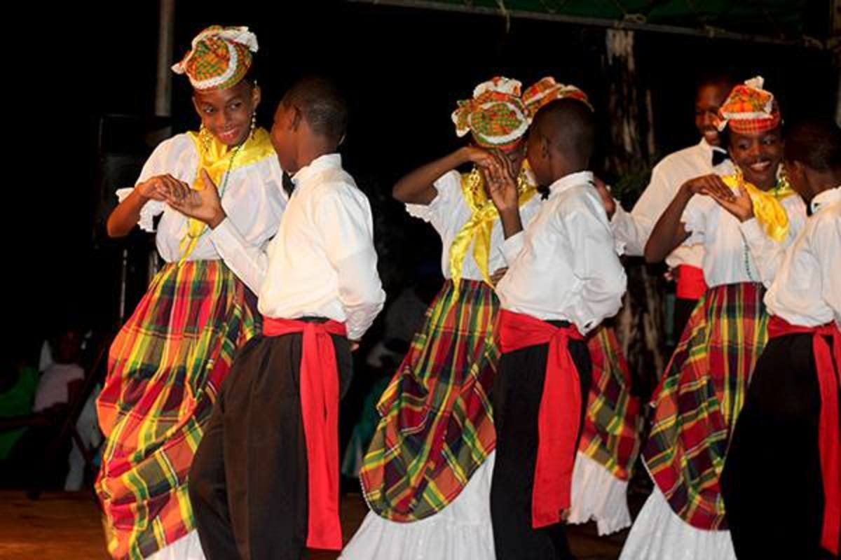 Little Boys and Girls perfuming on Stage wearing their traditional Dominican clothes...