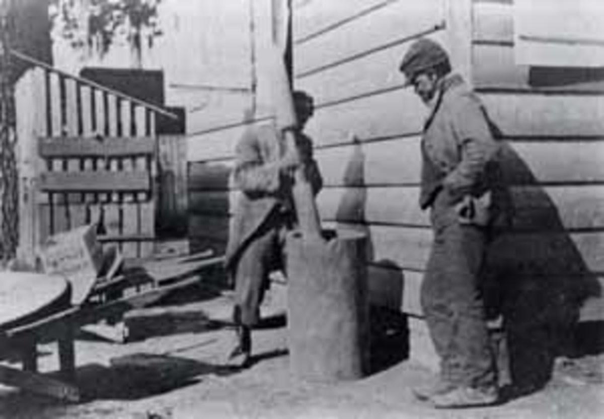 South Carolina Gullahs, about 1900. Men using a mortar and pestle.