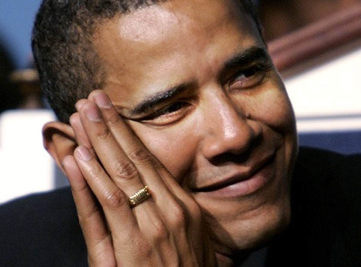 Former president Obama wearing a gold ring
