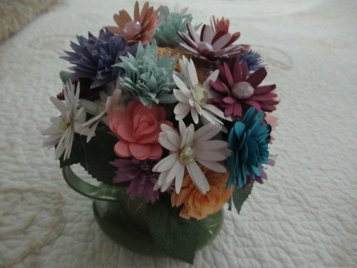 Rolled paper flower arrangement for spring. Flowers was made and then hot glued to the stem.