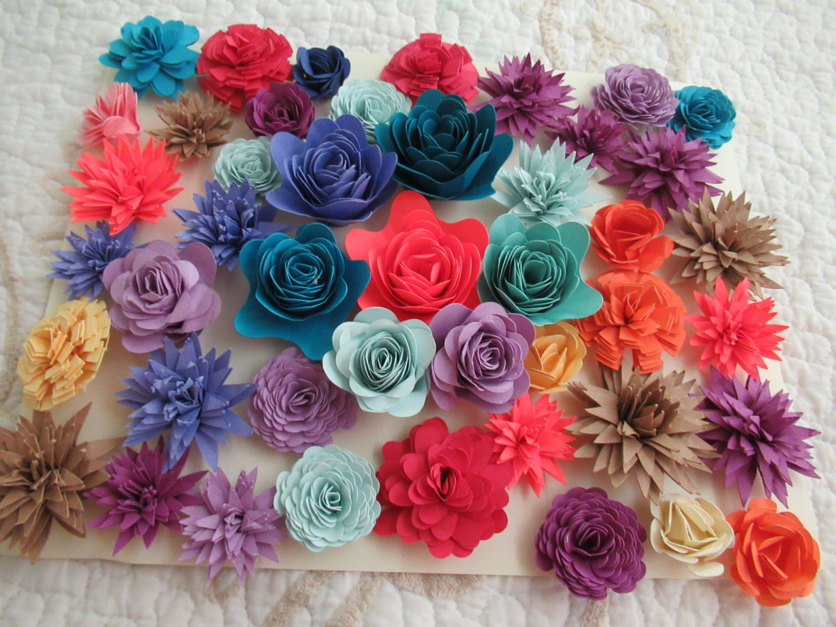 Here are just a few of my recently made rolled paper flowers. I keep them on hand for cards, scrapbook pages, wreaths and more