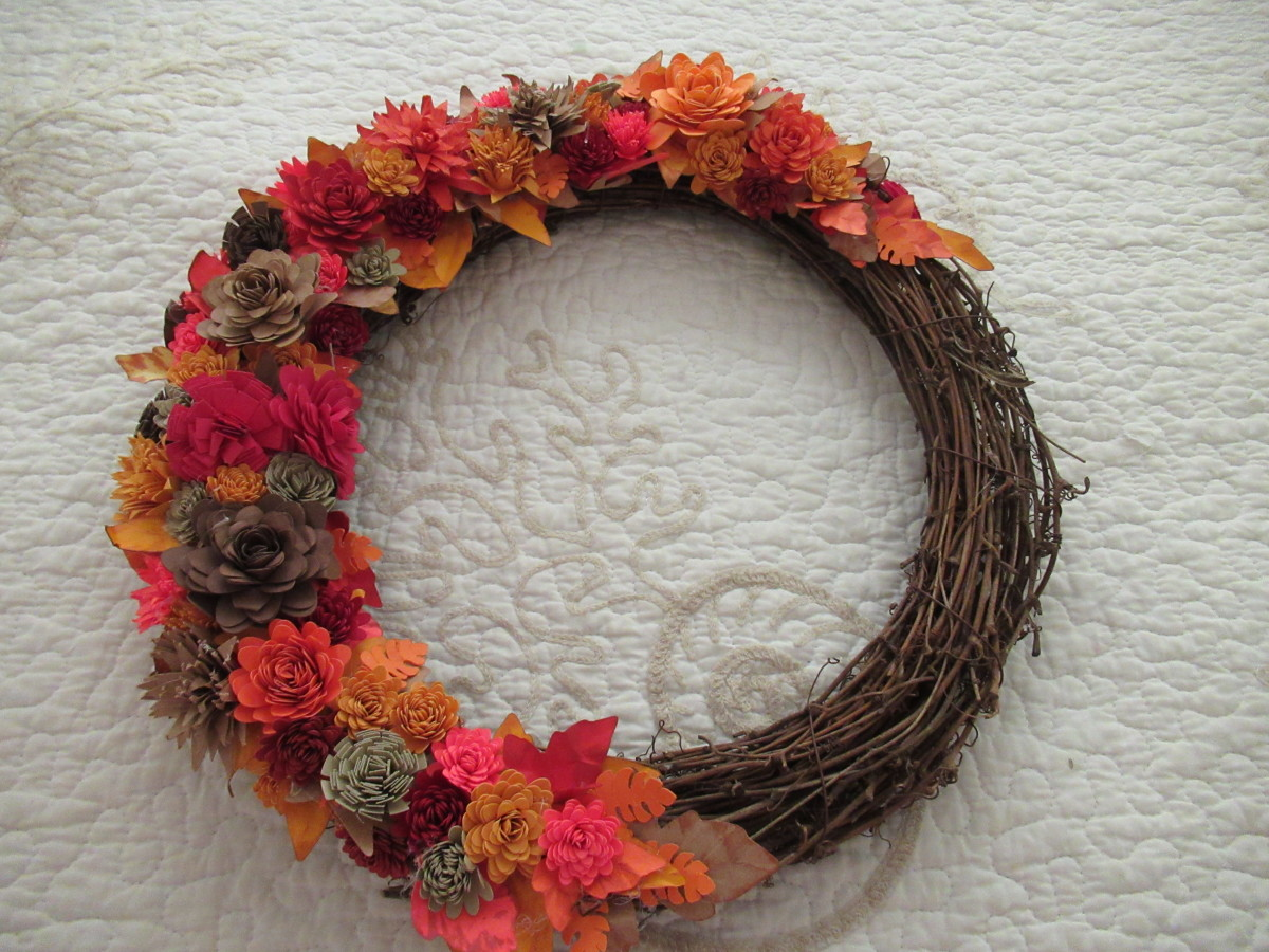 Rolled paper flowers are the perfect addition to any wreath. They can be done is seasonal colors. They can also be used for a baby shower in blue or pink. Chose white or bridal colors for a feature in bridal decor