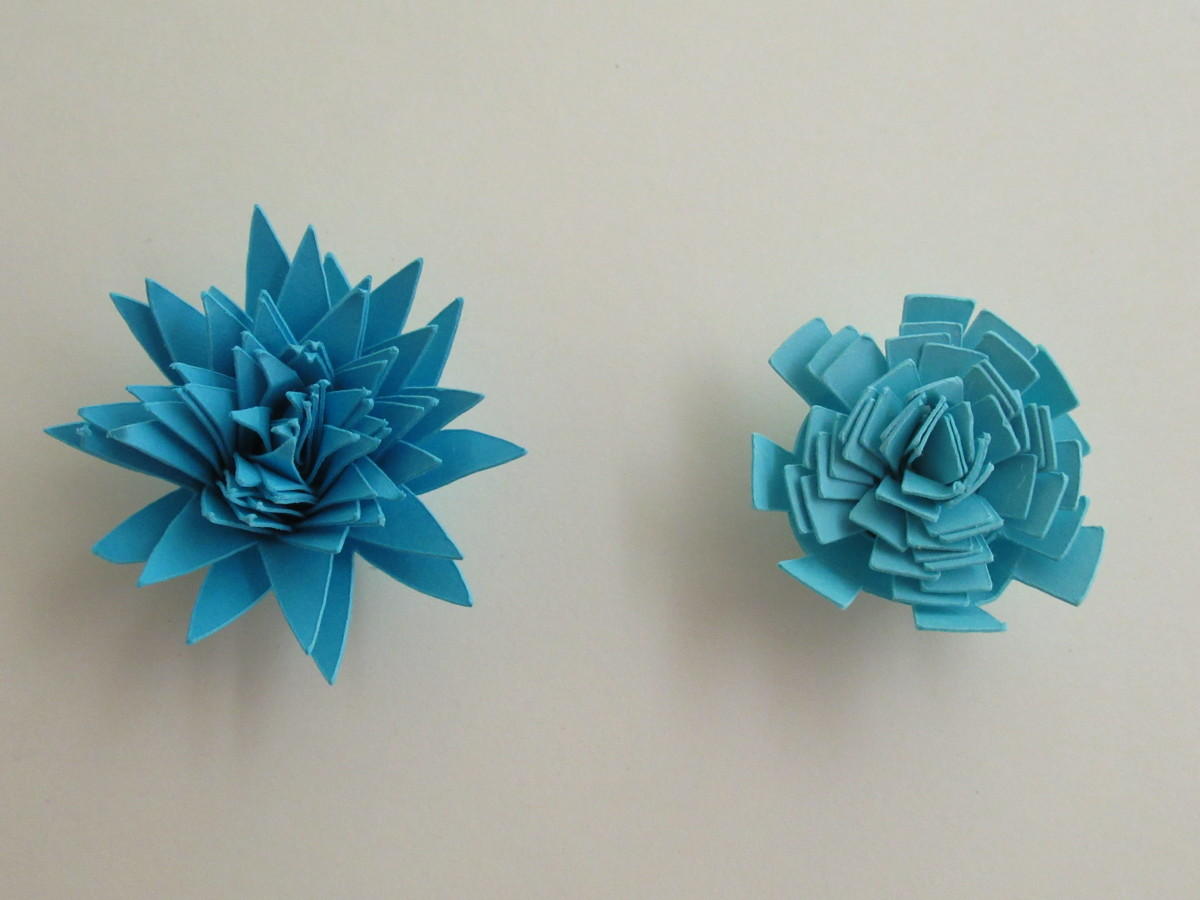 Once you have the flowers glued and they have dried, you can work the petals to create a more lifelike flower
