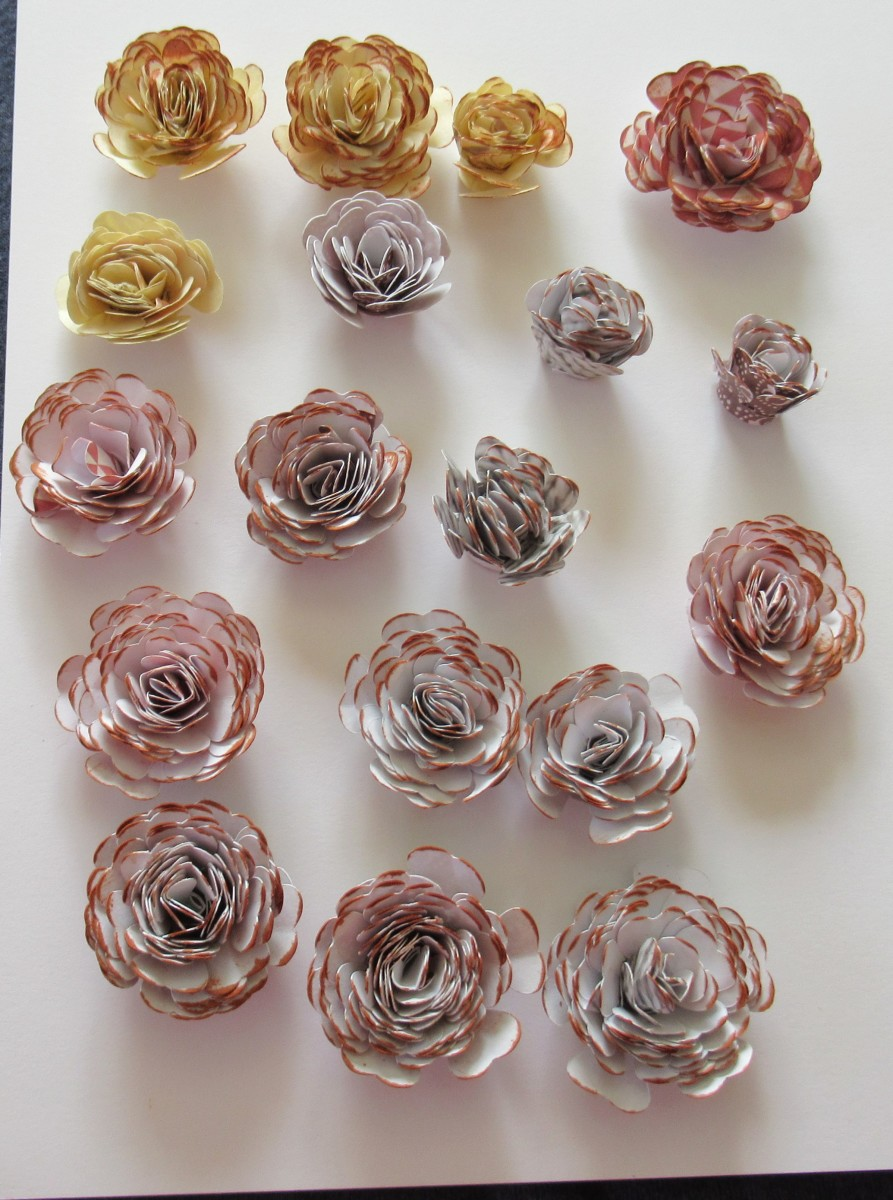 Gently run an ink pad over the top of your rolled flowers to create additional definition. I used a Momento ink called Potters Clay to create the drfinition on these flowers.