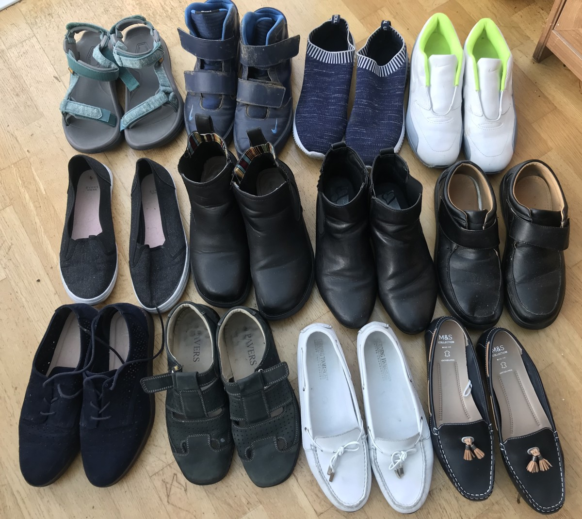 12 Pairs of women's shoes, L to R, top to bottom: 1. Teva sandals, 2, Nike high trainers, 3. Toisebon trainers, 4. Nike Air Max, 5. Evans Skater, 6. ankle boots, 7. Evans boots, 8. work shoes, 9. Brogues, 10. Pavers sandals, 11-12. loafer/boat