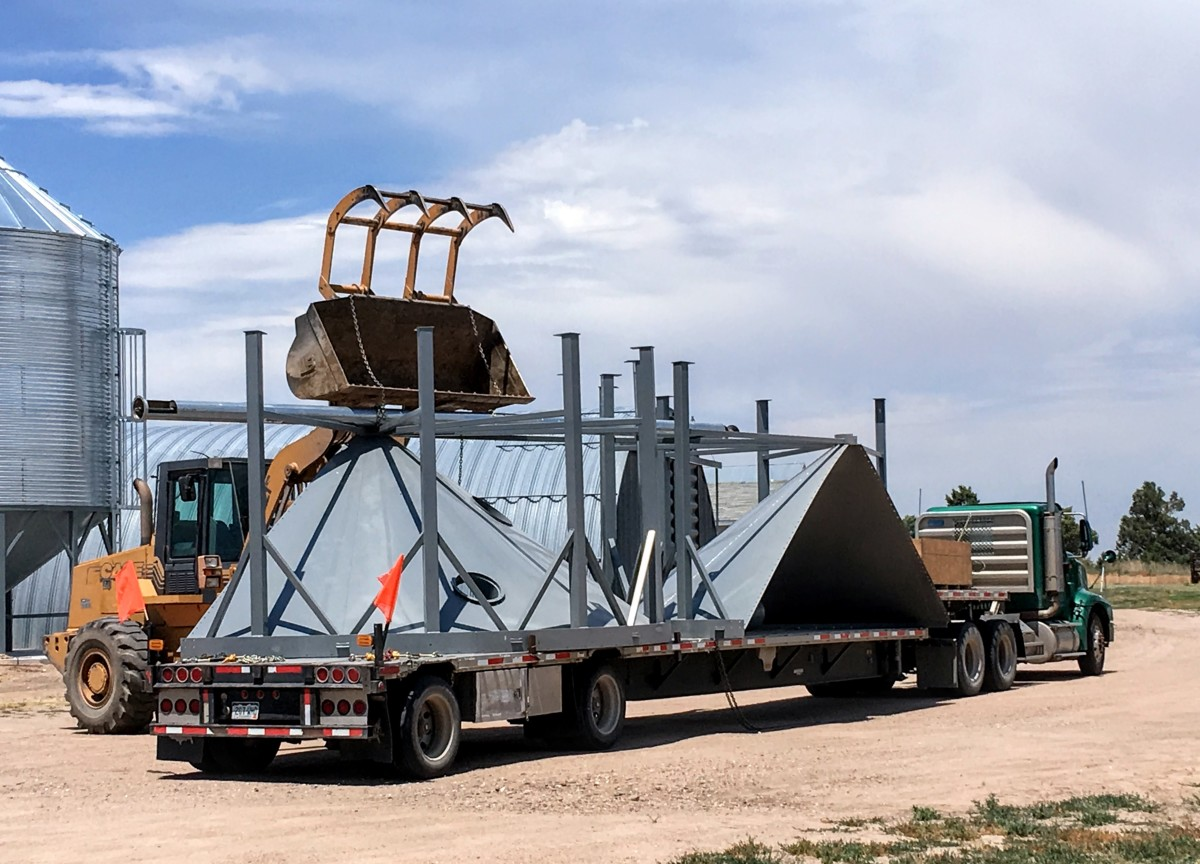 This newly-arrived hopper is ready to be taken off the truck using a loader and chains.