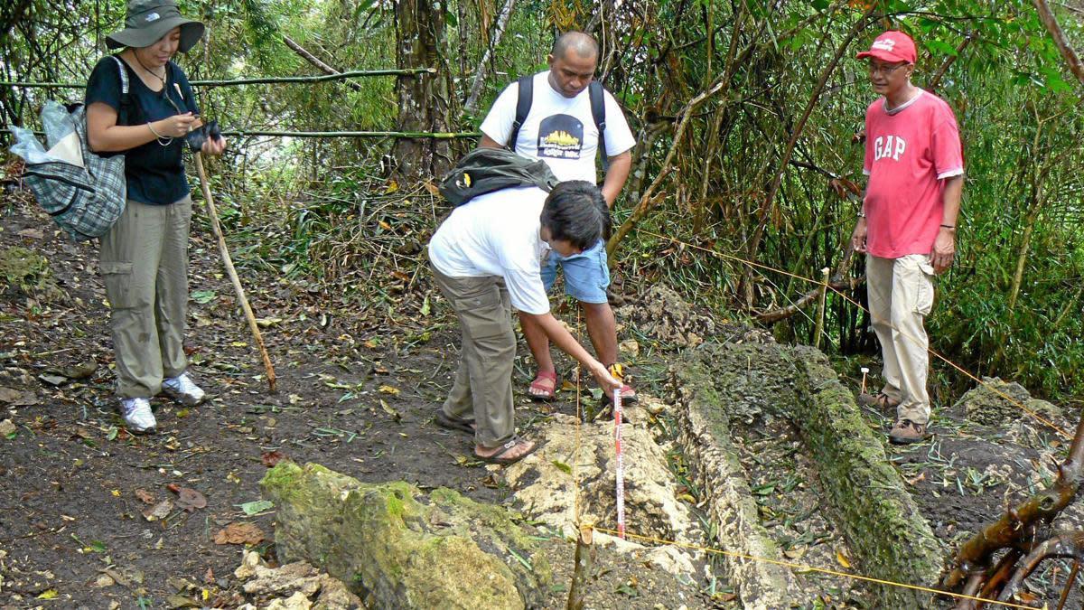 Examining the tombs.
