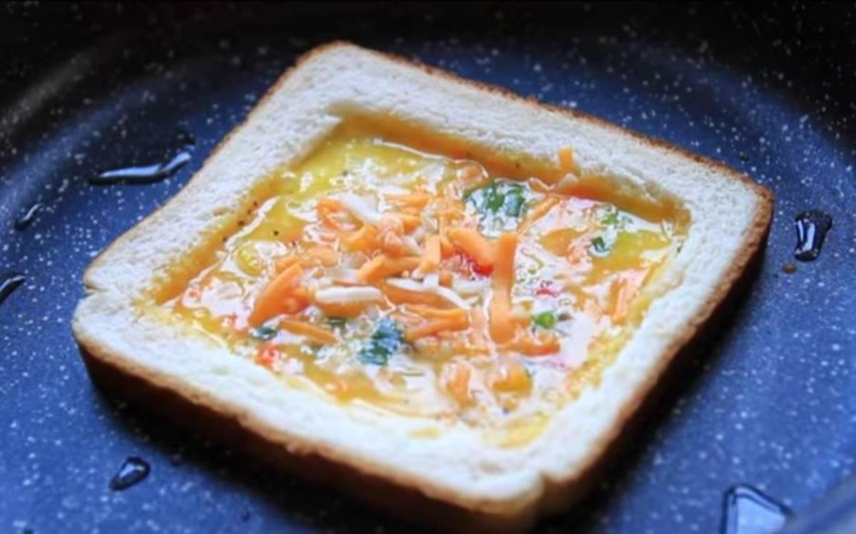 Bread placed in a pan & filled with vegetables.