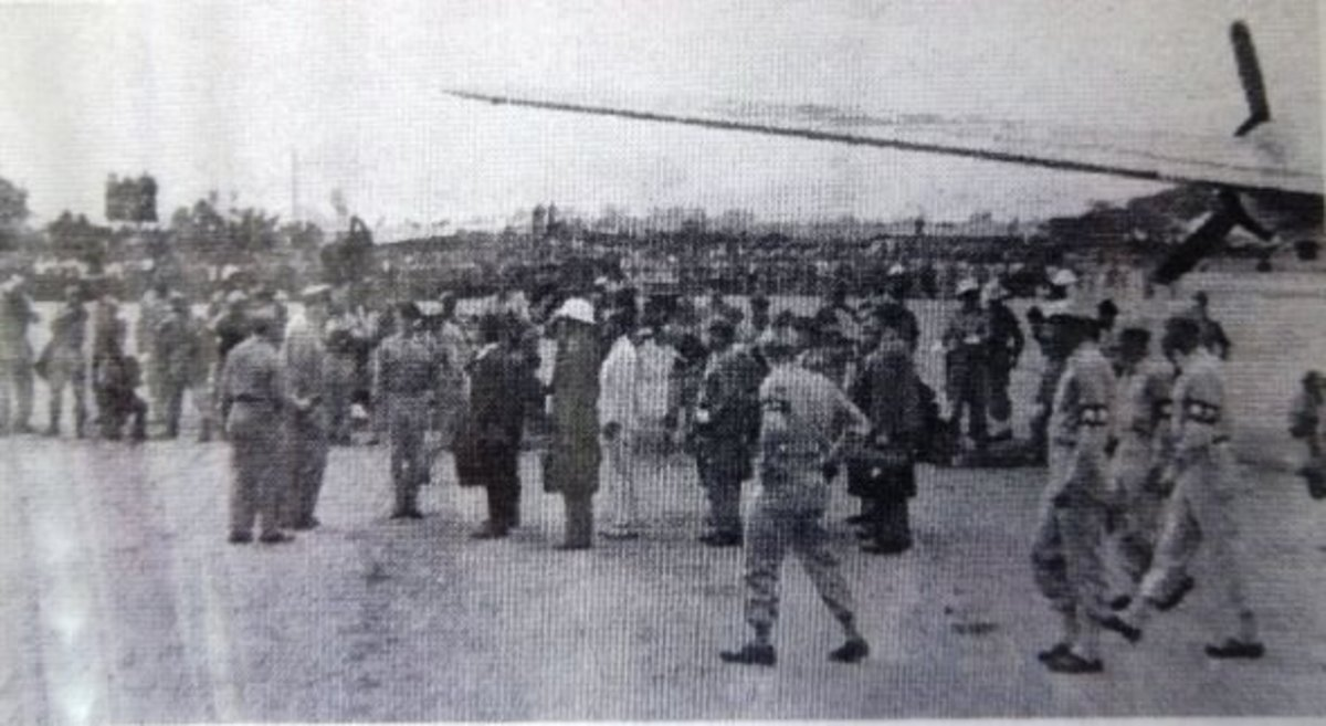 (M.P.'s escort the Japs to the waiting official escort)