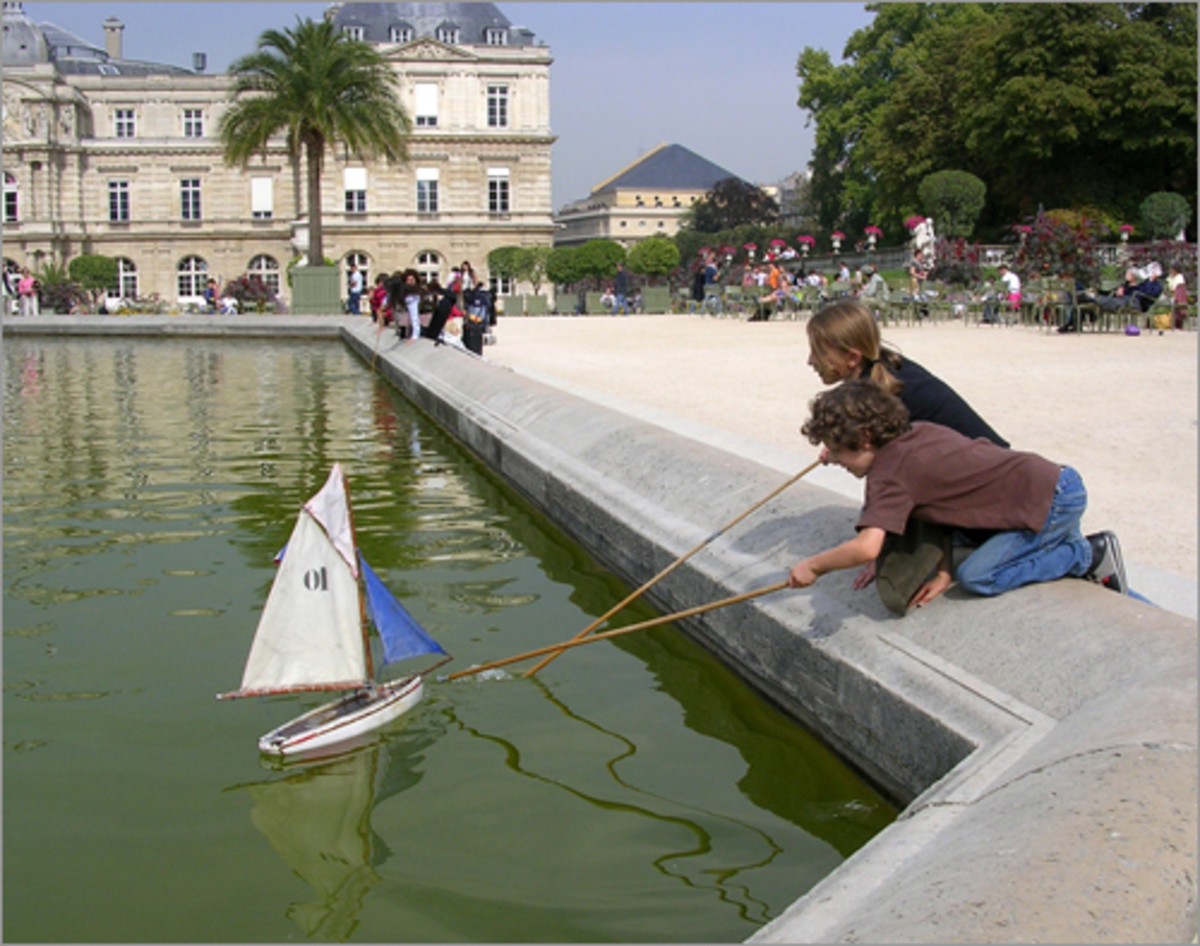 Children play with boats at Luxembourg Garden.
