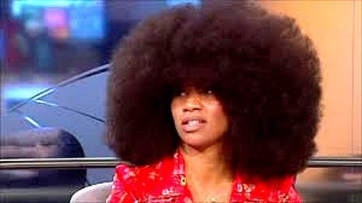 Aevin Dugas holds the world record for the woman with the largest Afro.