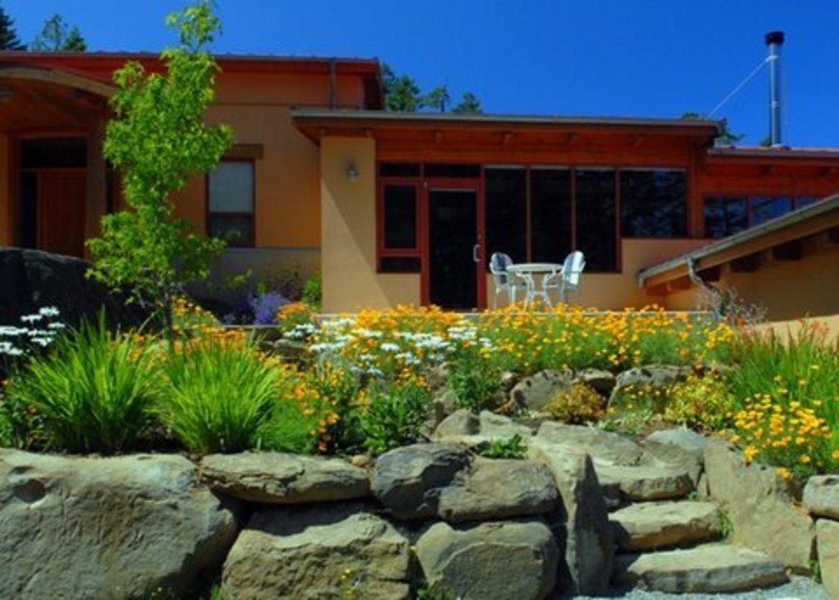 A Master's Masterpiece - my favorite sunken garden, tucked between a natural rock wall and the house.