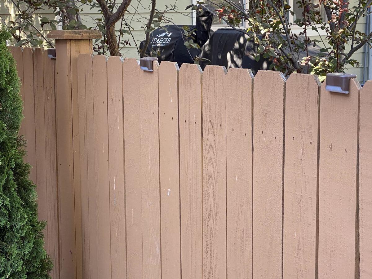 Solar Garden Lights adorn a fence