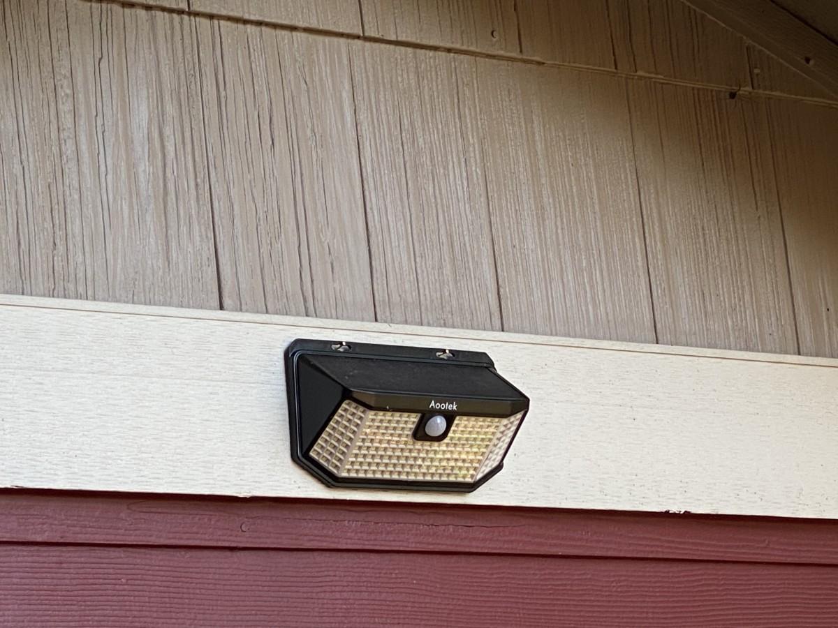 Motion detecting solar garden light for security