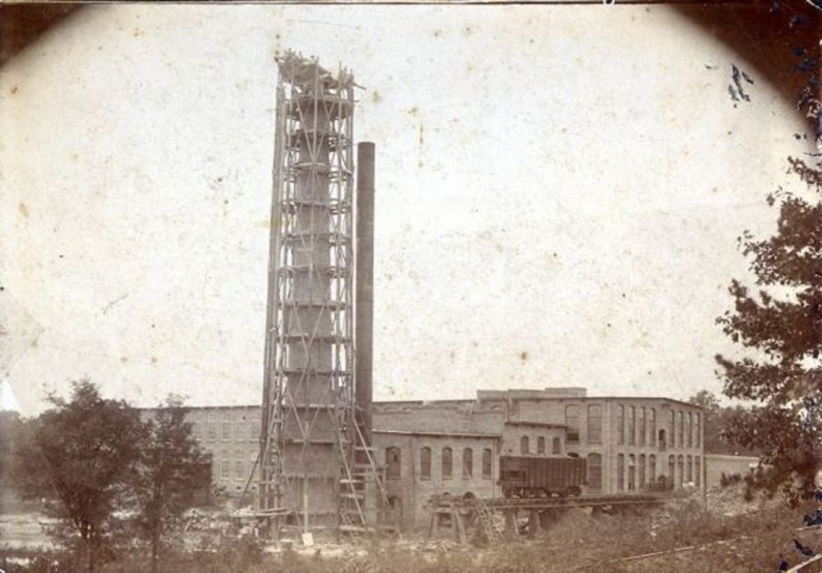 Nell said that her dad helped to build this smokestack at the Pendleton Cotton Mill in 1910. On the back of the photo was a note written by Virginia Boggs McKnight which reads:Papa (Charles Jackson Boggs) helped build this. A turkey dinner is being s