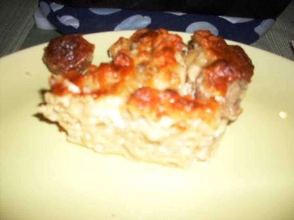 a slice of whole wheat macaroni pie with meatballs