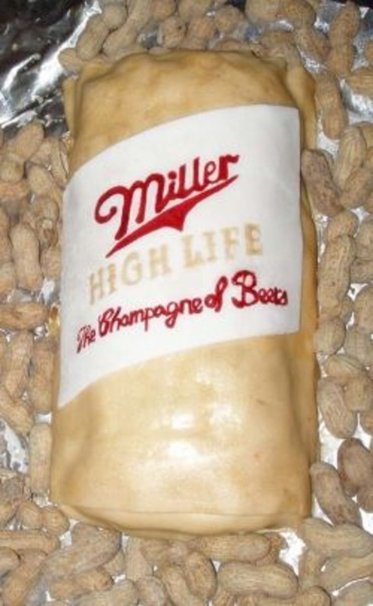 A lumpy beer can cake surrounded by peanuts