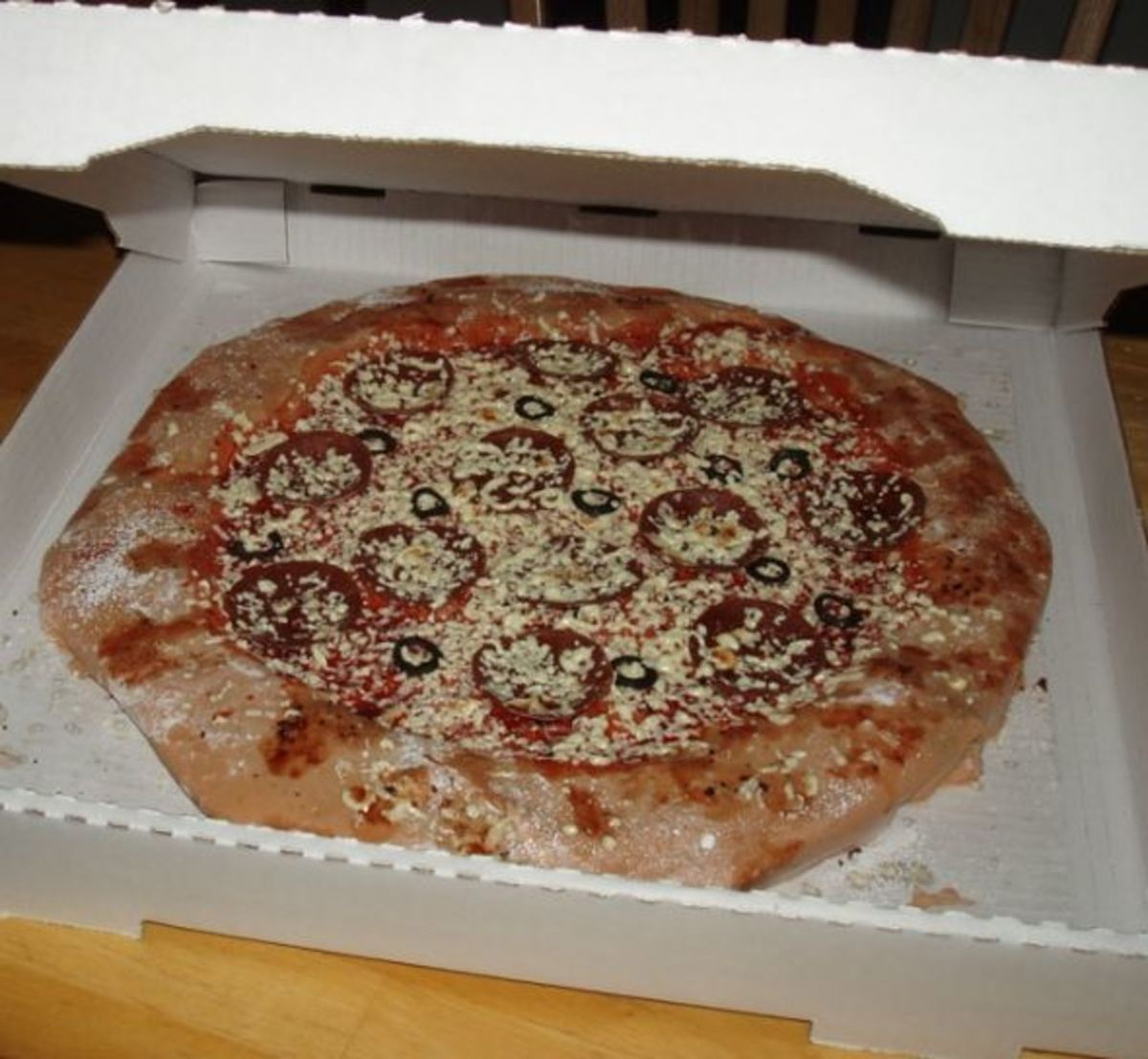 Realistic pizza cake in box