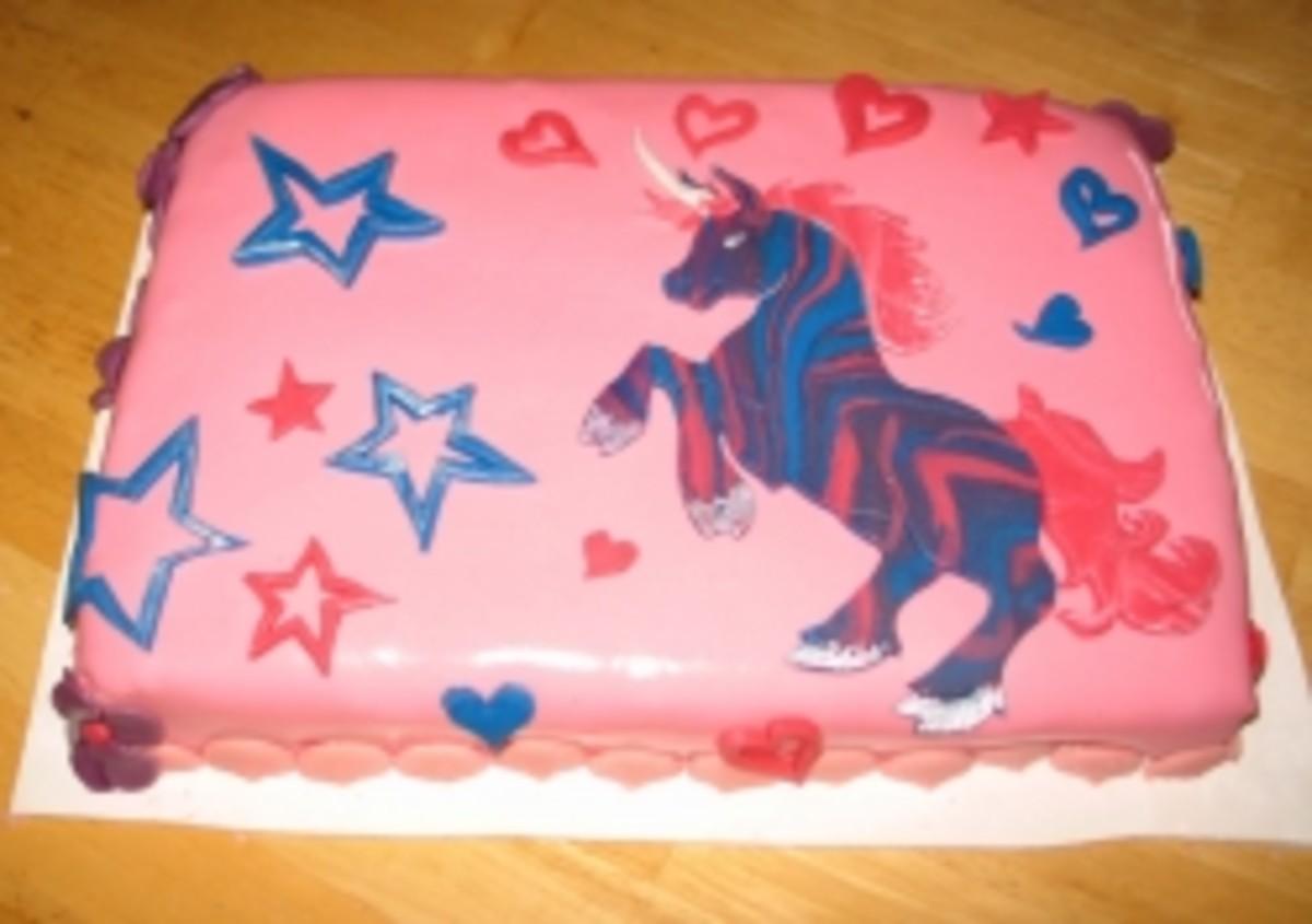 Zebra-striped unicorn cake with hearts