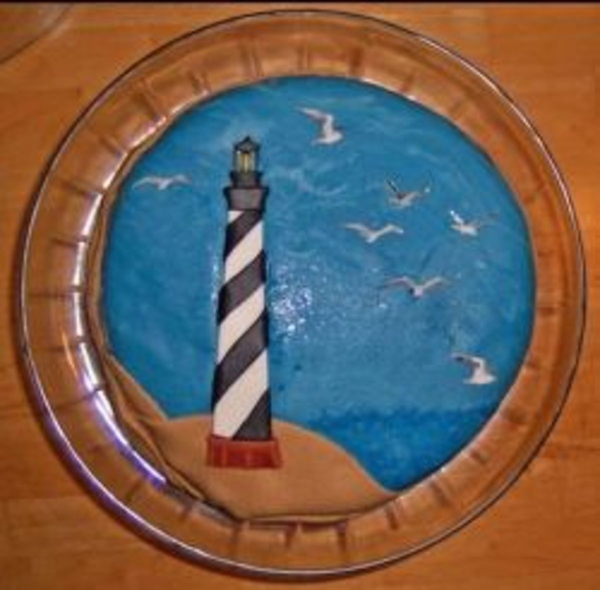Black and white striped lighthouse on a cake