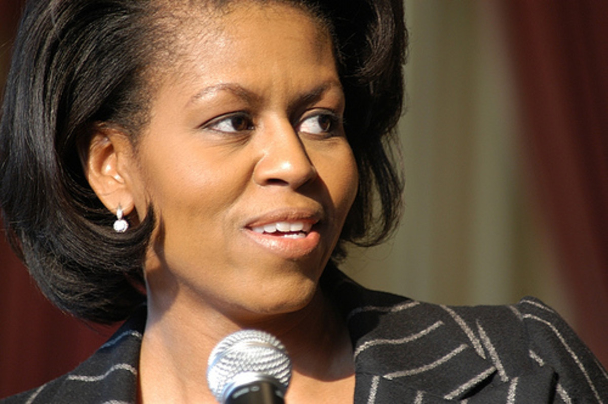 Michelle Obama's eyebrows are very arched in an oval shape, which causes her eyes to be highlighted and also creates a 'wide awake' look.