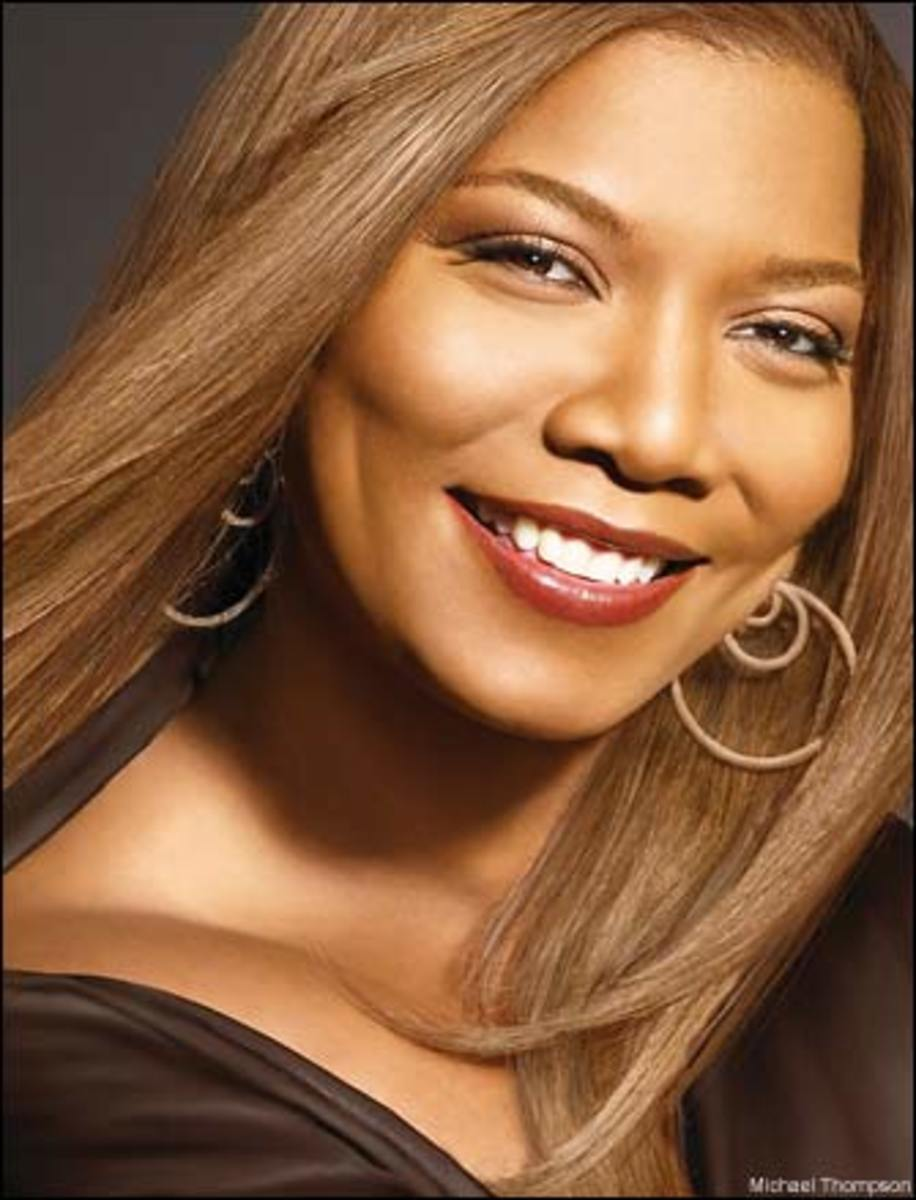 Queen Latifah's eyebrows are thick, long and naturally arched and compliment her round face very well.