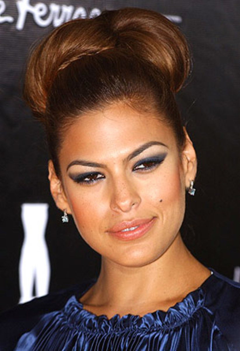 Eva Mendes' Eyebrows are very bold. Her cosmetic arch starts farther out than most eyebrow styles. Very unique.