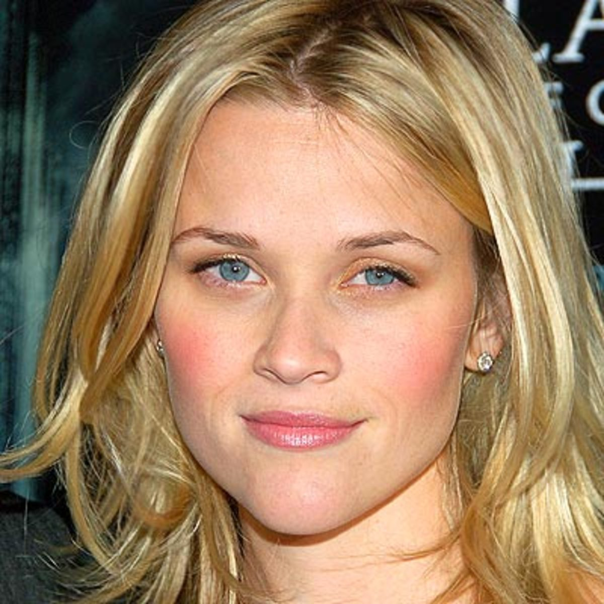 Reese Witherspoon's eyebrows appear small and take the emphasis from her eyes away, creating a focal point in the center of her face.