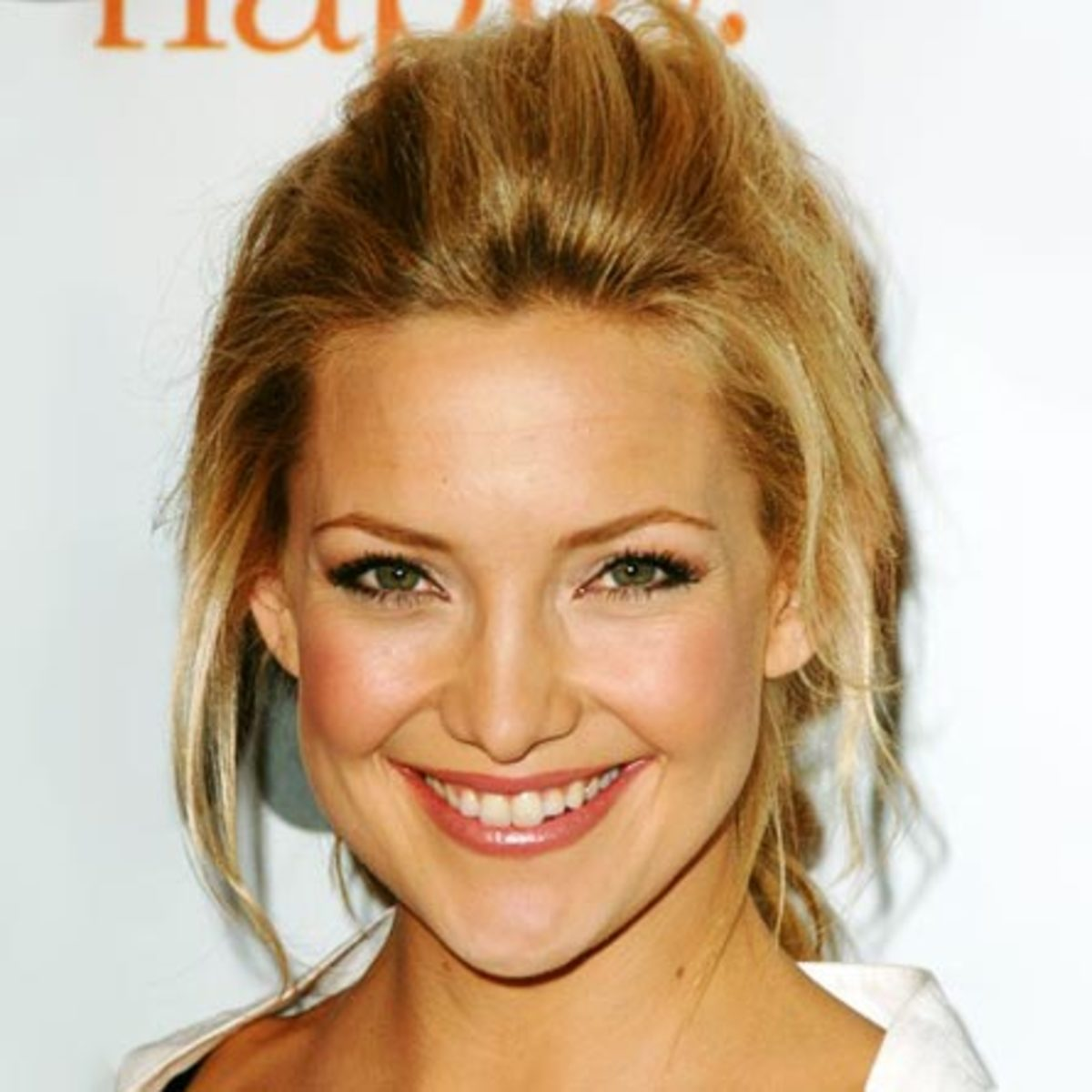 Kate Hudson's eyebrows have a very straight arch to them which emphasizes and opens up her smaller eyes.