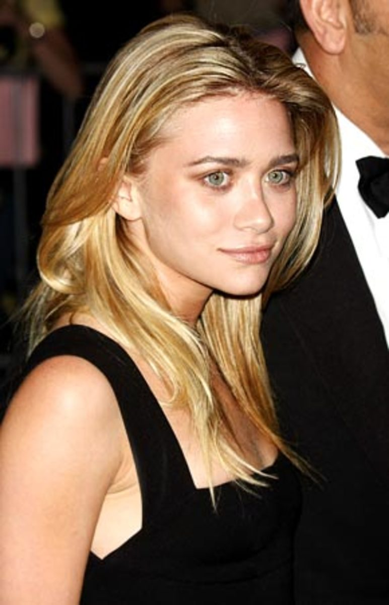 Mary Kate Olsen's eyebrows are very thick and have been grown out in this particular picture. They are a bit dominant for her face because of the thickness and color.