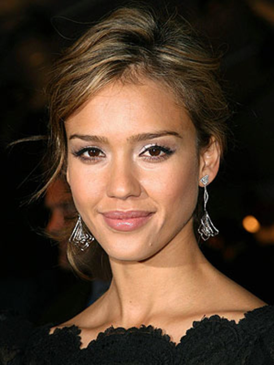 Jessica Alba's eyebrows are also very long. They start very close to the middle of the eyes and extend past the outer edge.