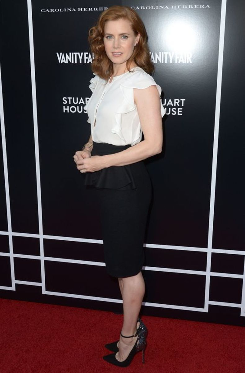 Amy Adams is elegant in a black pencil skirt and ankle strap high heels on the red carpet
