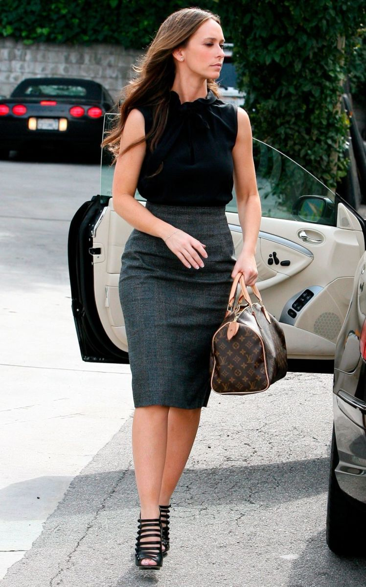Jennifer Love Hewitt in a classic gray pencil skirt and gladiator-style towering high heels