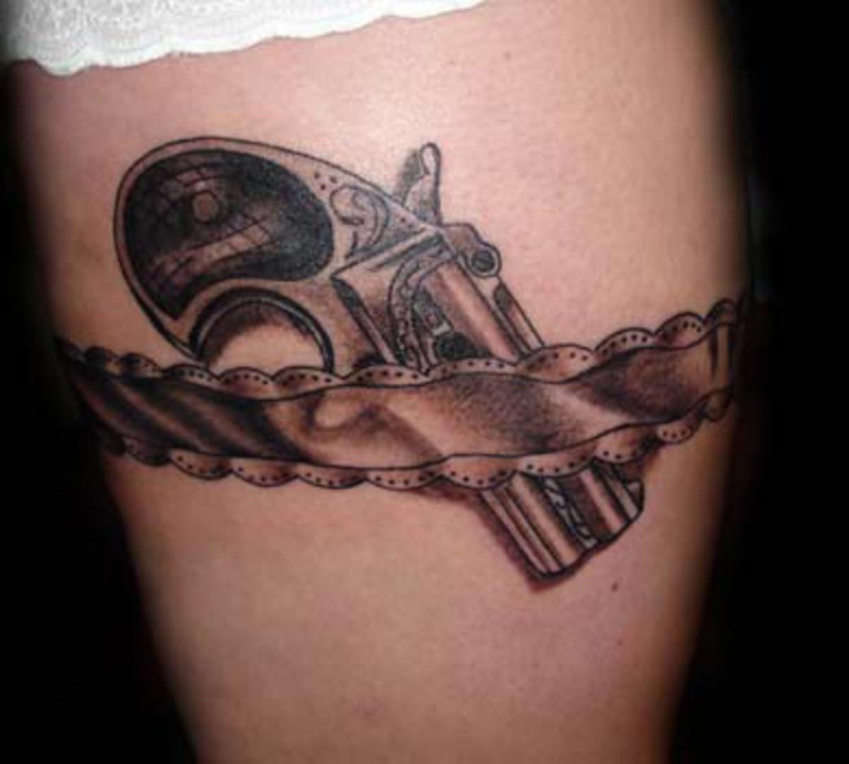 Derringer in Garter Tattoo